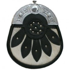 SPORRAN is black leather with a Celtic cantle, a white cowhide base on the front over layed with lea