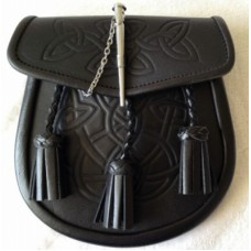 Black smooth leather embossed with a Celtic pattern.